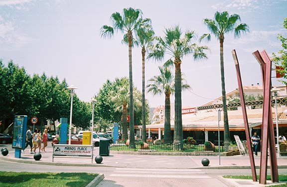 Palm trees and restaurants in the sunny resort of Magaluf